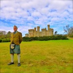 in kilt in front of Lews Castle